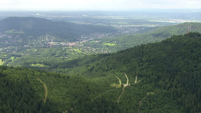 ws aerial view of mountains and downtown / baden baden, baden wurttemberg, germany - schwarzwald stock-videos und b-roll-filmmaterial