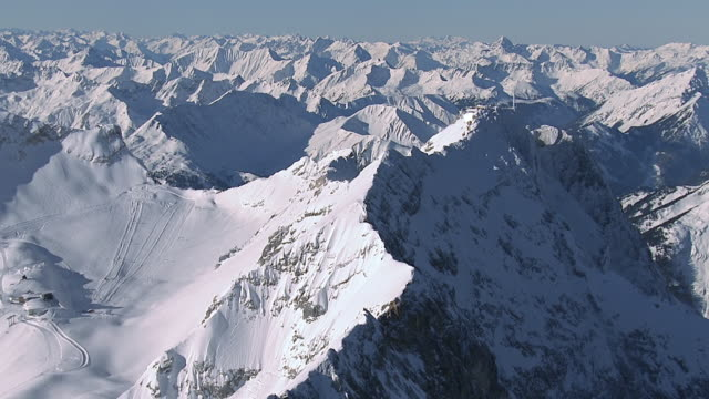 ws aerial ds view of mountains / zugspitze, bavaria, germany - alpi video stock e b–roll
