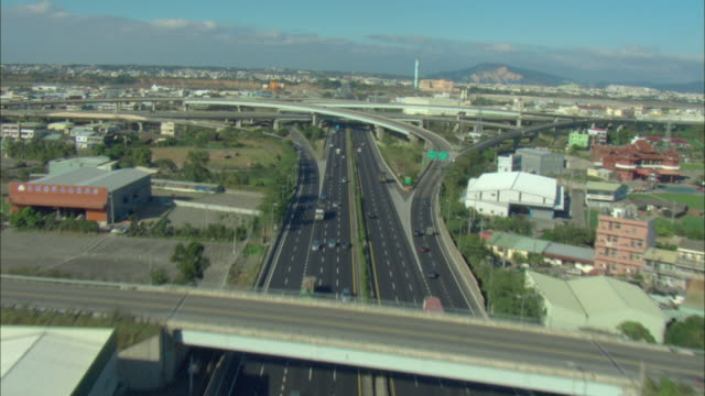 WS POV AERIAL View of multiple highways and intersection running throughout Taichung City in Taiwan / Taichung City, Taiwan, Taiwan