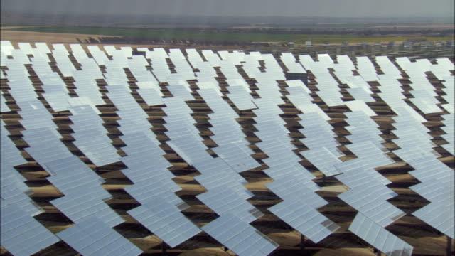ws pan view of multiple rows of solar panels in field / sanlucar la mayor, seville, spain - abundance stock videos & royalty-free footage