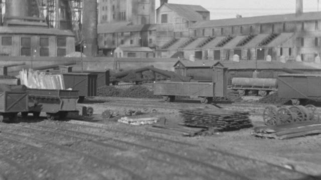 ms view of munitions plant railroad tracks with some buildings  - shunting yard stock videos and b-roll footage