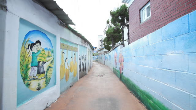 view of mural of cheonan village in jungang-dong (popular tourist destinations) - female likeness stock videos & royalty-free footage