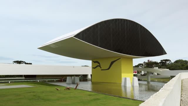 ws pan view of museo oscar niemeyer / curitiba, brazil  - oscar niemeyer stock videos and b-roll footage
