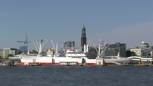 WS View of museum ship Cap San Diego and church of St. Michael near river Elbe/ Hamburg, Germany