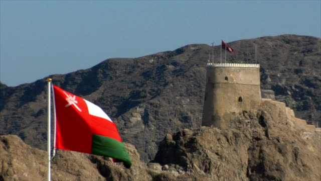 ws view of mutrah fort with omani flag in foreground, muscat, oman - oman flag stock videos and b-roll footage