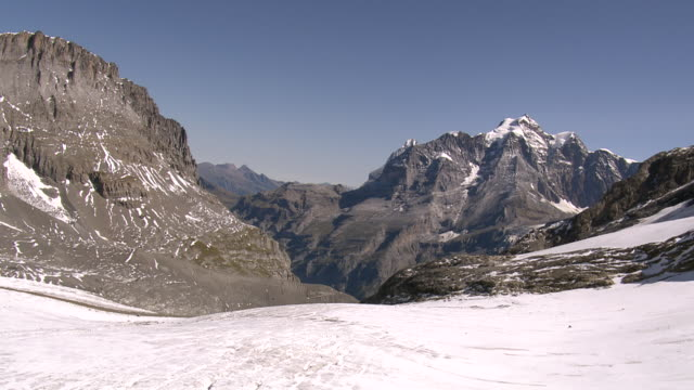ws aerial view of mutthorn hut and tschingelfirn / tschingelfirn, bern, switzerland - 30 seconds or greater stock videos & royalty-free footage