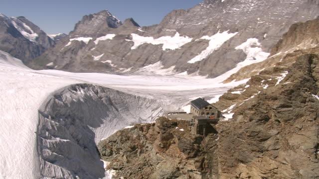 WS AERIAL View of Mutthorn hut and tschingelfirn / Tschingelfirn, Bern, Switzerland