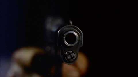cu  view of muzzle of  revolver - handgun stock videos & royalty-free footage
