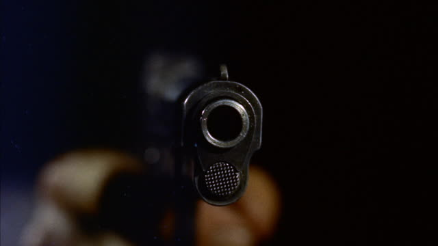 cu  view of muzzle of  revolver - arma da fuoco video stock e b–roll