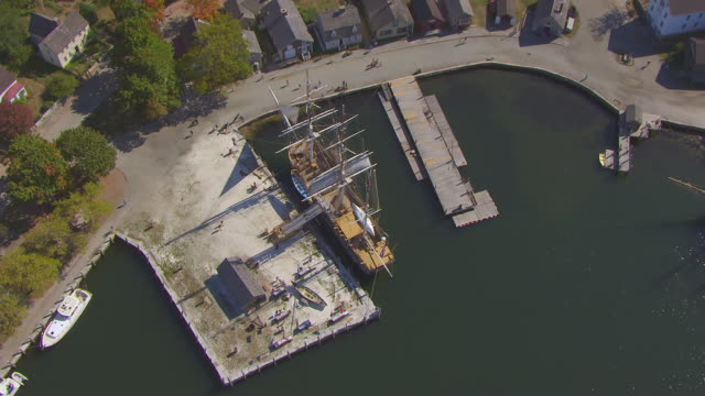 ws zi aerial pov view of mystic seaport with charles w. morgan ship / mystic, connecticut, united states - new london county connecticut stock videos & royalty-free footage