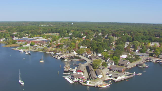 ws aerial pov view of mystic seaport with charles w. morgan ship / mystic, connecticut, united states - new london county connecticut stock videos & royalty-free footage