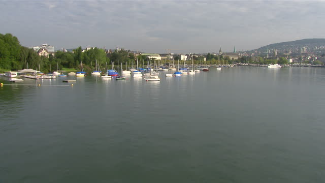 WS AERIAL View of Mythenquai at Lake Zurich with buildings for rowing clubs and Lake Police / Enge, Zurich, Switzerland