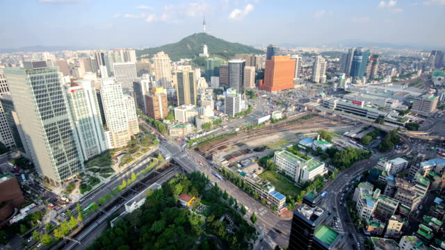 view of n seoul tower (famous tourist destinations) and a crossroad at a eastern part of seoul station - クロスワード点の映像素材/bロール