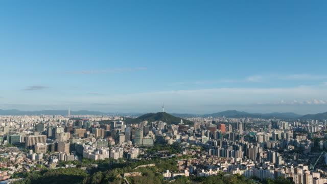vídeos y material grabado en eventos de stock de view of n seoul tower (famous tower for tourist) and city buildings in seoul at day - señal de nombre de calle