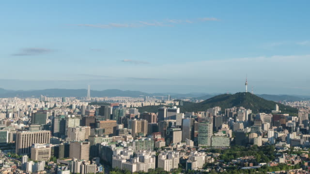 view of n seoul tower (famous tower for tourist) and city buildings in seoul at day - straßenschild stock-videos und b-roll-filmmaterial