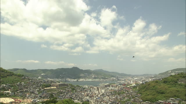 view of nagasaki city - schwenk nach unten stock-videos und b-roll-filmmaterial