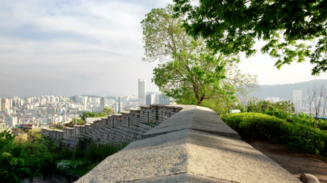 view of naksan park (tourist attraction) stone wall - stone wall stock videos and b-roll footage