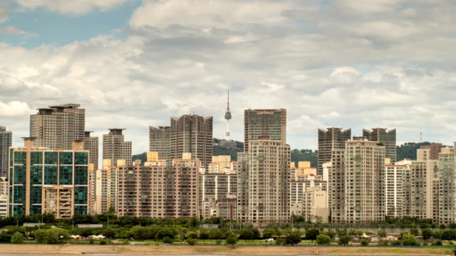 view of namsan mountain beyond the city buildings in seoul - personal land vehicle stock videos & royalty-free footage