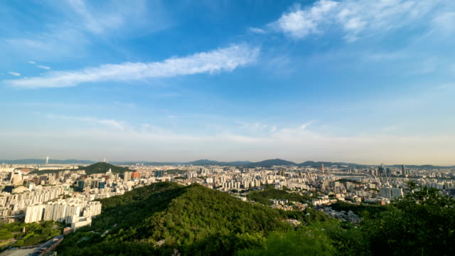 view of namsan mountain to yeouido area with city buildings at daytime in seoul - distant点の映像素材/bロール