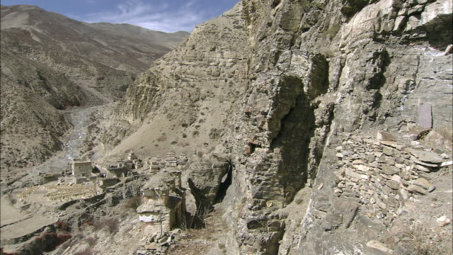 ws pan view of nan gompa tibetan buddhist monastery / high himalayas, upper dolpo near tibetan border, nepal  - monastery stock videos & royalty-free footage