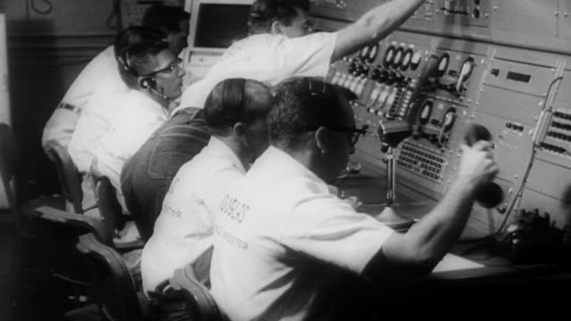 ms view of  nasa mission control / united states - 1960 stock-videos und b-roll-filmmaterial