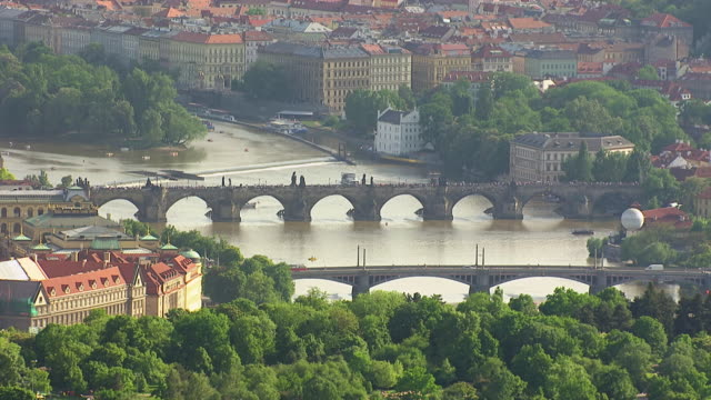 WS AERIAL View of national theatre and bridge over vitava river / Prague, Czech Republic