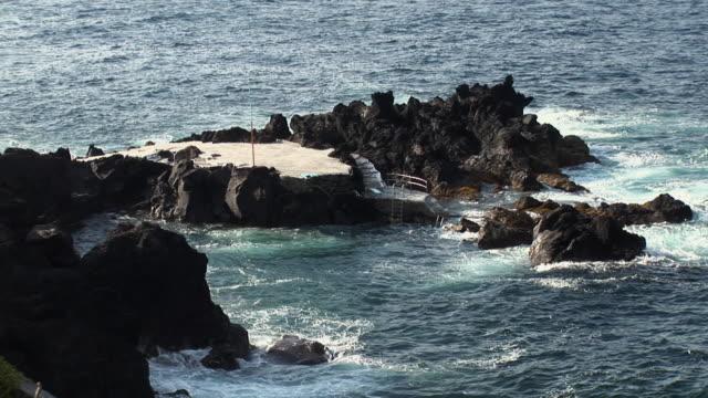 ms view of natural pool of azores / sao mateus da calheta, terceira, portugal - アゾレス諸島点の映像素材/bロール