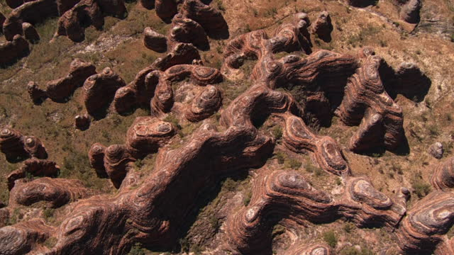aerial ws ds slo mo view of natural rock formations at national park  / purnululu, western australia, australia - dolly shot stock videos & royalty-free footage