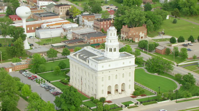ws aerial pov zo view of nauvoo temple and cars moving on road / nauvoo, hancock county, illinois, united states - mormonism stock videos & royalty-free footage