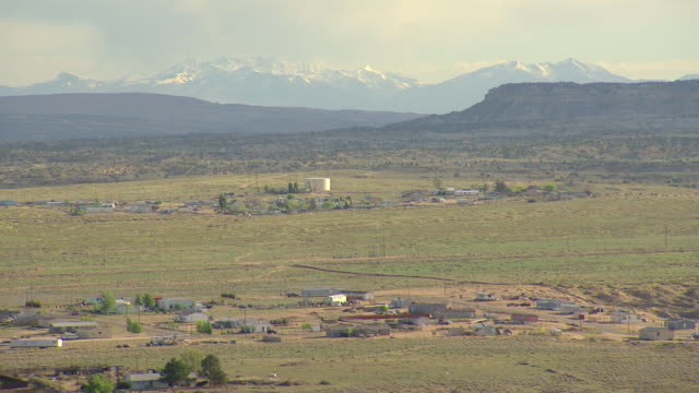 ws aerial view of navajo reservation with snowy peaks on mountains in san juan county / new mexico, united states - navajo reservation stock videos and b-roll footage
