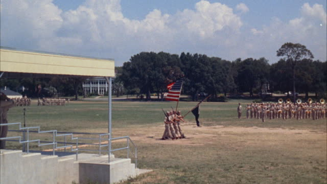 ws pan view of navy dress review at large military base - military training stock videos & royalty-free footage