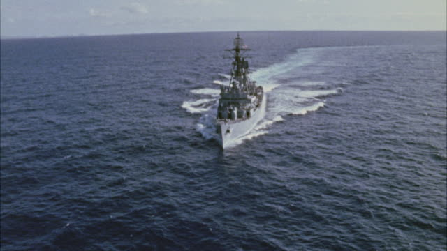 ms arial view of navy ship in ocean - warship stock videos & royalty-free footage