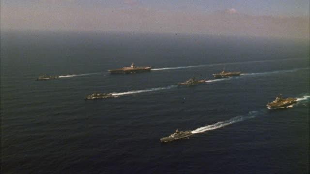 WS View of navy ships in ocean