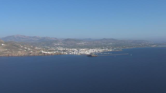 WS AERIAL View of naxos city and coastline with sailboat / Naxos, Cyclades, Greece