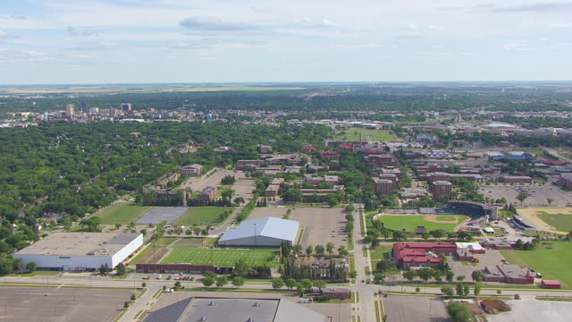 WS AERIAL View of NDSU campus with baseball field and tennis courts at North Dakota State University / Fargo, North Dakota, United States