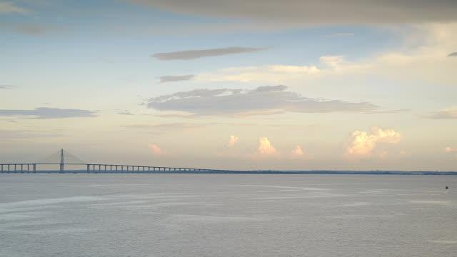 stockvideo's en b-roll-footage met ws t/l view of negro river with iranduba bridge / manaus, amazonas, peru - color negro