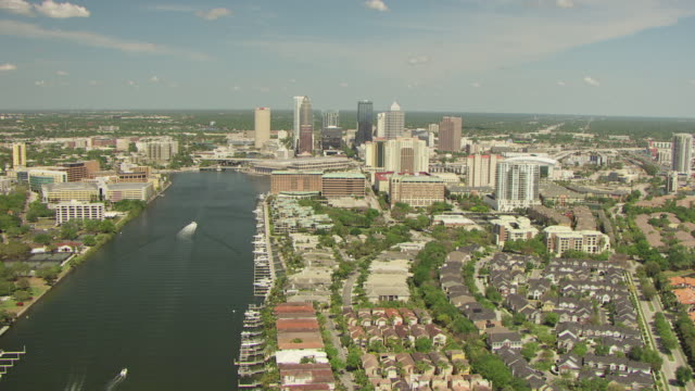 ws aerial view of neighborhood to downtown tampa along river / tampa, florida, united states - tampa stock videos & royalty-free footage