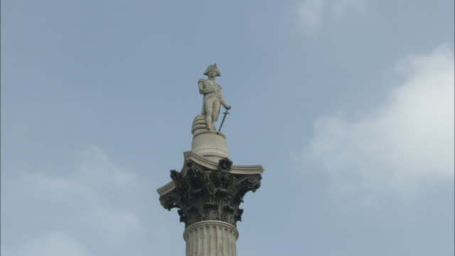 ws pov  view of nelson's column against sky / trafalgar square, london, england - nelson's column stock videos and b-roll footage