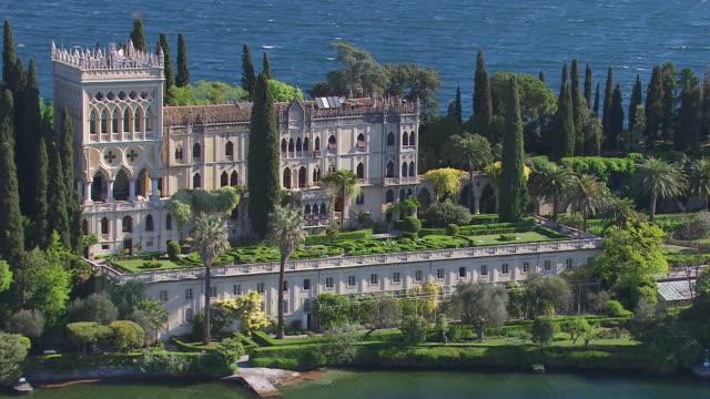 WS AERIAL View of neo gothic style villa at lake Garda / Lake Garda, Trentino, Verona, Brescia