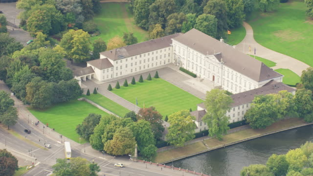 ws aerial zi view of neoclassical palace, official residence of president / berlin, germany - government building stock videos and b-roll footage