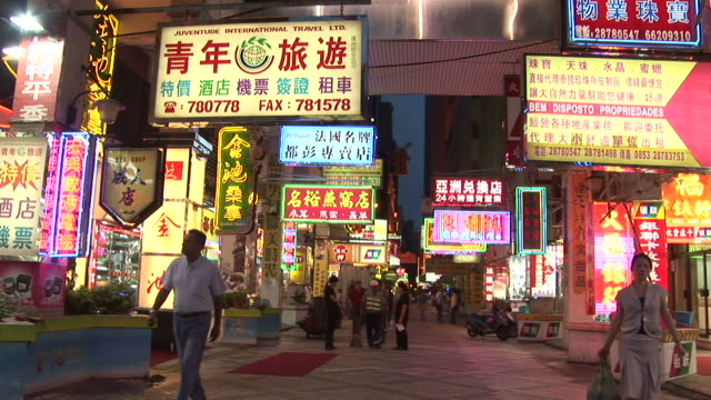 View of neon signboards at night in Macau China