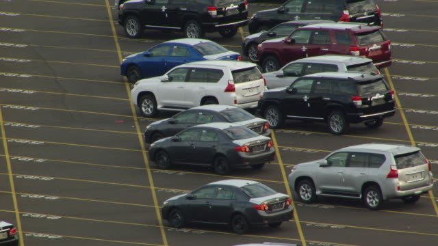 ms aerial view of new automobile imports in lot at port of portland / oregon, united states - cars parked in a row stock videos & royalty-free footage