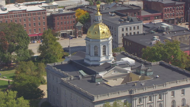 ws aerial pov view of new hampshire state house / concord, new hampshire, united states - dome stock videos & royalty-free footage