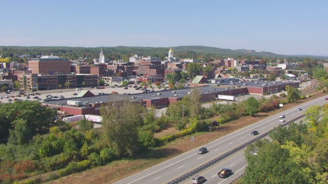 ws tu aerial pov view of new hampshire state house passing over river / concord, new hampshire, united states - new hampshire stock videos & royalty-free footage