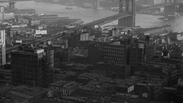ws view of new york city with buildings and bridges below - brooklyn bridge stock videos & royalty-free footage