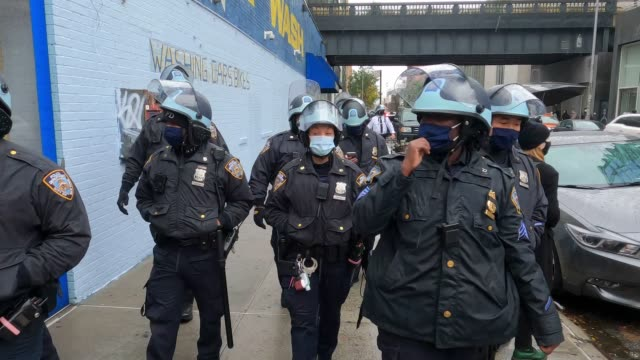 a view of new york police department presence during an antifascism protest in the chelsea neighborhood of manhattan on november 1 2020 in new york... - anti fascism stock videos & royalty-free footage
