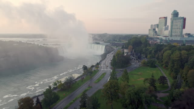view of niagara falls(horseshoe falls) and cityscape in ontario, canada at daytime - wide stock videos & royalty-free footage