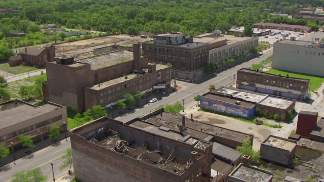 WS AERIAL POV View of nice homes with green lawns and dilapidated buildings / Lake County, Gary, Indiana, United States