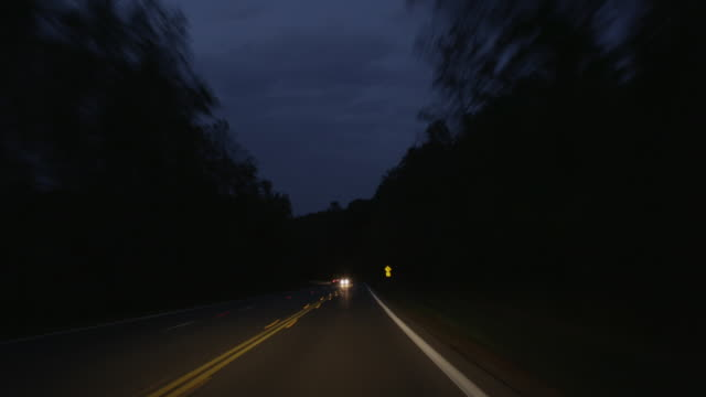 MS POV T/L View of night on two lane highway / Waynesboro, Virginia, United States