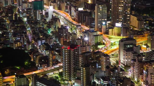 WS T/L View of night scene of azabu juban elevated highway junction / Tokyo, Japan